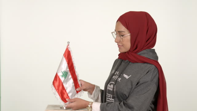 girl wearing hijab holding lebanese flag - lebanese flag stock videos and b-roll footage