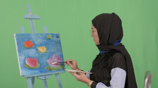 girl wearing hijab painting - modest clothing stock videos & royalty-free footage