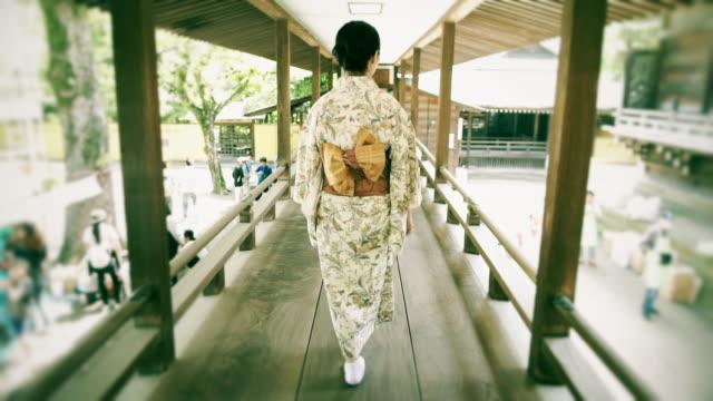 Girl Wearing Kimono Walking on Elevated Walkway