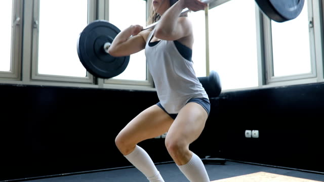 girl weightlifting - flexing muscles stock videos and b-roll footage