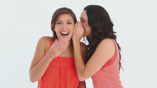 girl whispers into friends ear - whispering stock videos & royalty-free footage