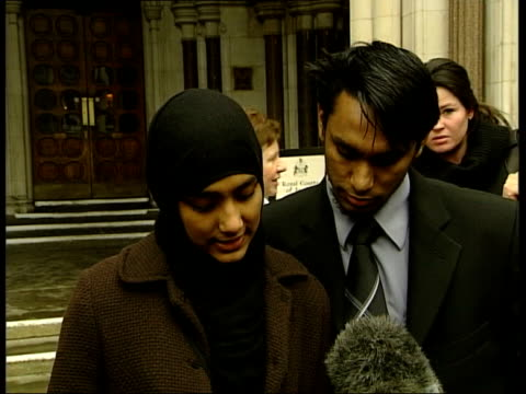 vídeos y material grabado en eventos de stock de girl wins right to wear islamic dress to school; england: london: ext lms shabina begum towards from court with her brother shuweb rahman press begum... - number 9