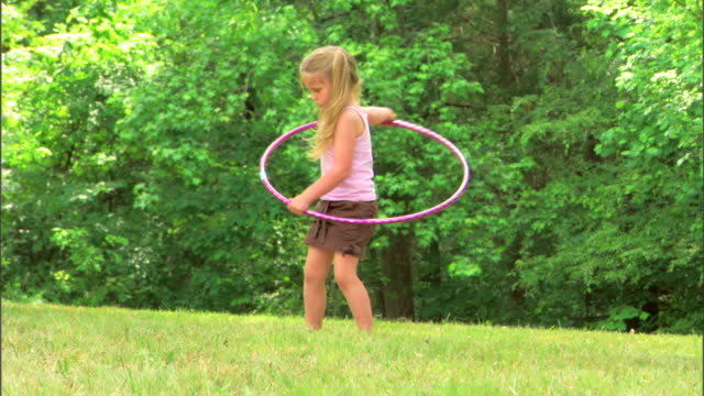 girl with a plastic hoop toy - see other clips from this shoot 1428 stock videos & royalty-free footage