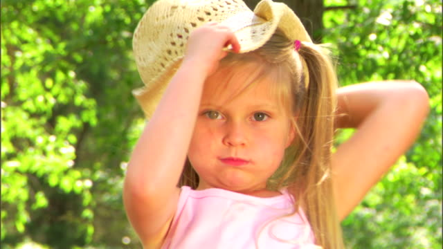 girl with a straw hat - straw hat stock videos & royalty-free footage