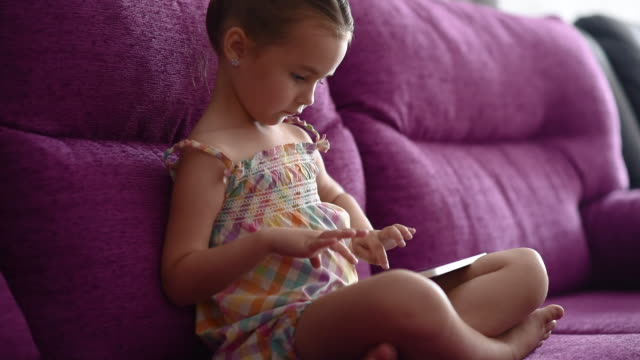 girl with a tablet computer - gambe incrociate video stock e b–roll