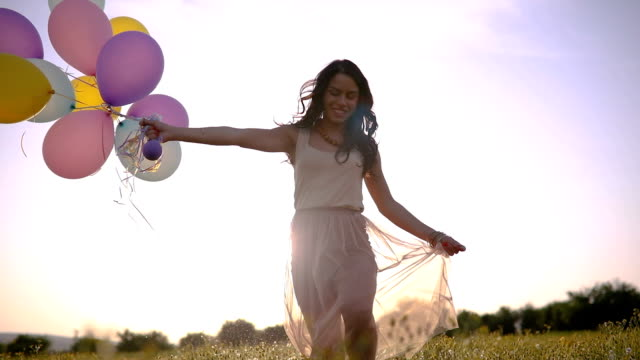 girl with balloons in slow motion - balloon stock videos and b-roll footage