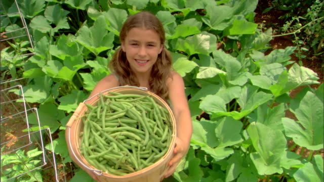 Girl with basket of string beans
