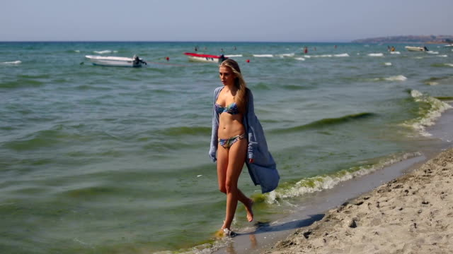 girl with bikini and pareo is walking on beach - sarong stock videos and b-roll footage