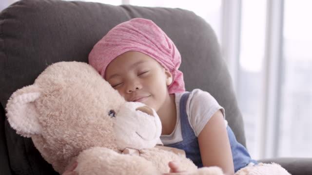 girl with cancer hugs teddy bear - teddy bear stock videos & royalty-free footage