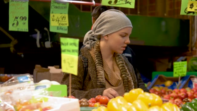 Girl with cancer shopping for produce
