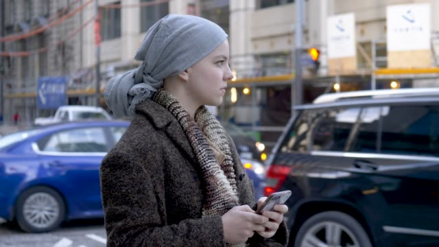 girl with cancer texting - headscarf stock videos & royalty-free footage