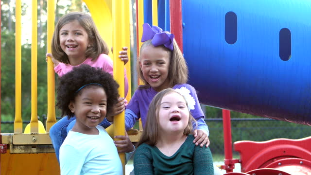 girl with down syndrome and friends on playground - schoolgirl stock videos and b-roll footage