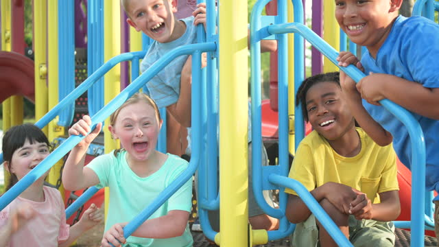 girl with down syndrome, friends at playground - 8 9 years stock videos & royalty-free footage