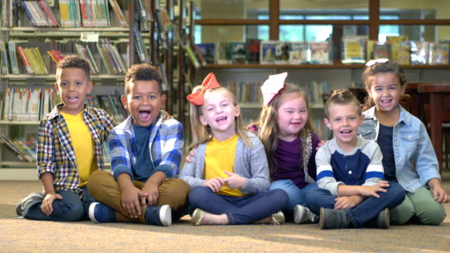 girl with down syndrome, friends in library - elementary student stock videos & royalty-free footage