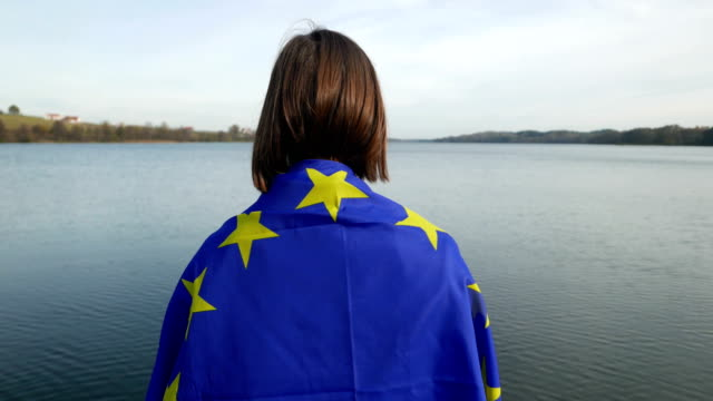 girl with eu flag at the lake - european union stock videos & royalty-free footage
