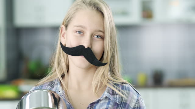 girl with fake mustaches - moustache stock videos and b-roll footage