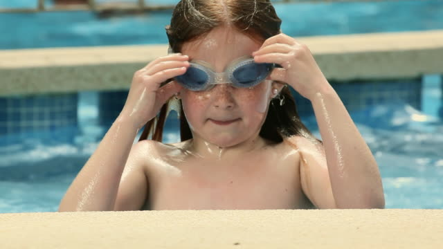 cu girl (6-7) with goggles coming out of pool and smiling /  palma de mallorca, mallorca, baleares, spain - young girls stripping stock videos and b-roll footage