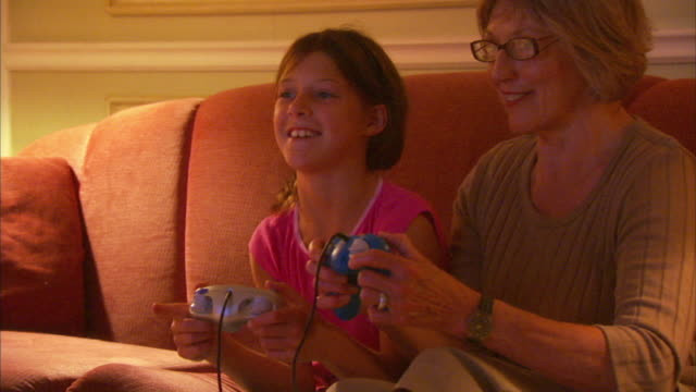 MS Girl (8-9) with grandmother playing video game, Halifax, Nova Scotia, Canada