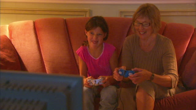 ms girl (8-9) with grandmother playing video game, halifax, nova scotia, canada - three quarter length stock videos & royalty-free footage