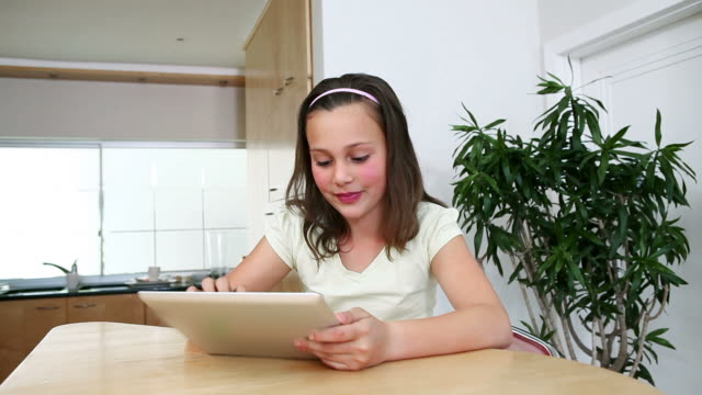 girl with a tablet computer in the kitchen - kosmetisches stirnband stock-videos und b-roll-filmmaterial