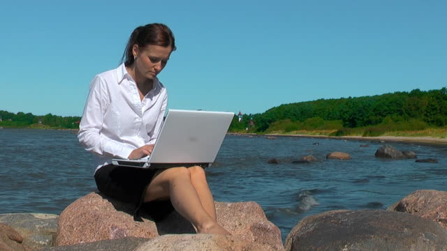Girl with Laptop by the Sea