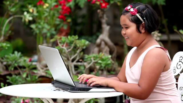girl with laptop - overweight child stock videos & royalty-free footage
