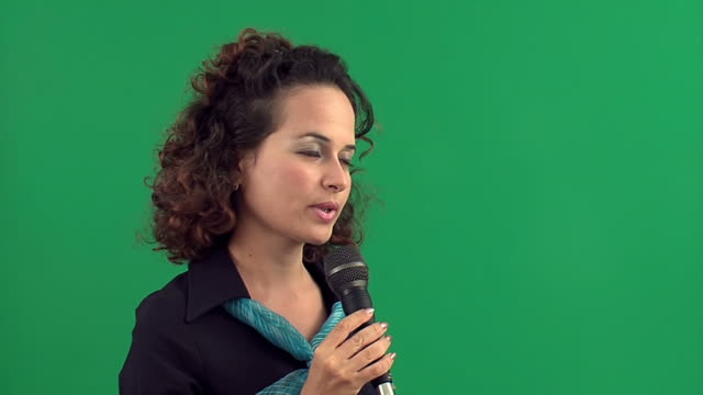girl with microphone on chroma key - commentator stock videos & royalty-free footage