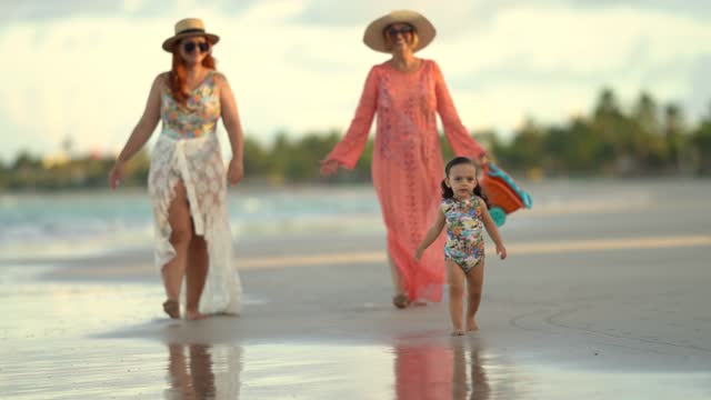 girl with mother and grandmother walking on the beach - general view stock videos & royalty-free footage