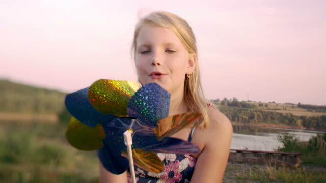 Girl with pinwheel sequence