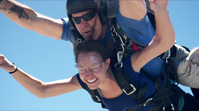 Girl With Pretty Smile Does Tandem Skydive