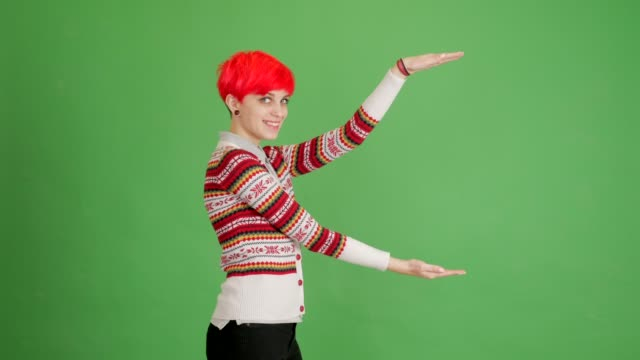 girl with red hair shows copy space on green background - blouse stock videos & royalty-free footage