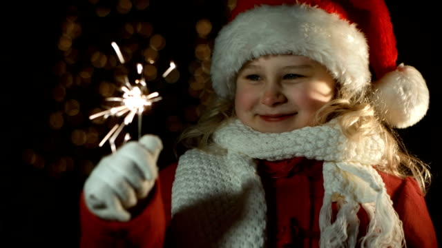 girl with santa hat holding a sparkler - santa hat stock videos & royalty-free footage