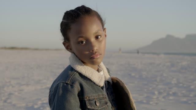vidéos et rushes de girl with skateboard standing at beach - partie d'une série