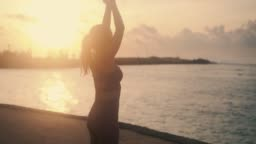 girl with slim body raises and lowers hands stretching