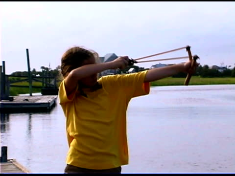 girl with slingshot - catapult stock videos & royalty-free footage