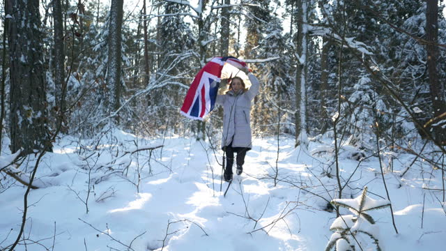 girl with the flag of great britain in winter aura - british royalty stock videos & royalty-free footage
