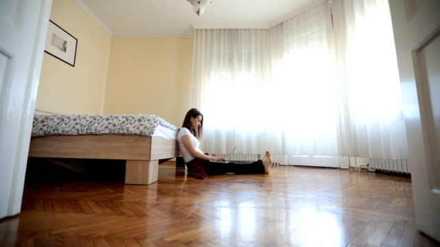 girl working in bedroom on laptop - wooden floor stock videos & royalty-free footage