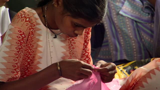 cu td girl working on embroidery project with prerana women's group, lalkuan, uttarakhand, india - 仕立て屋点の映像素材/bロール