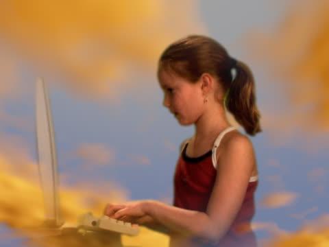 girl (8-10) working on laptop computer - digital enhancement stock videos & royalty-free footage