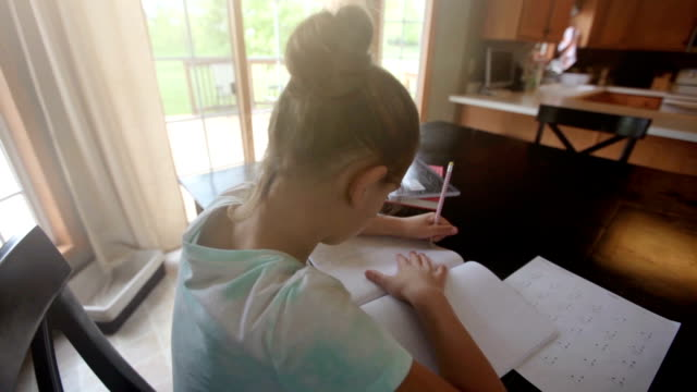 girl working on math homework - homework stock videos & royalty-free footage