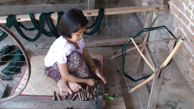 MS Girl working with Hands spinning wheel / Rangoon, Myanmar
