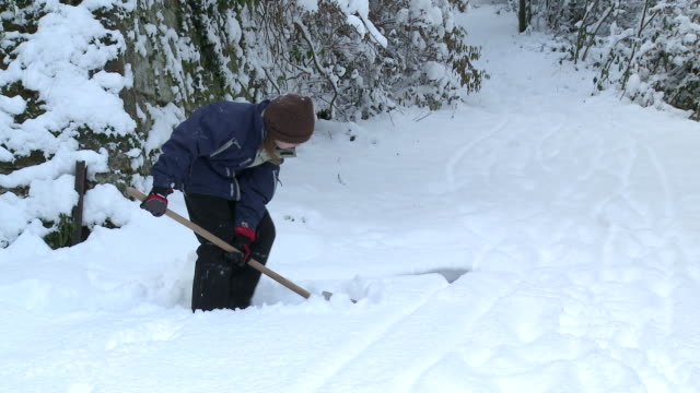 MS Girl working with snow punsher / Saarburg, Rhineland-Palatinate, Germany
