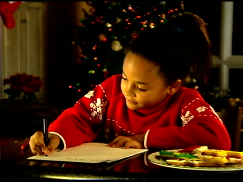 girl writing letter to santa for christmas - see other clips from this shoot 1407 stock videos and b-roll footage