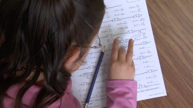 cu, ha, girl (8-9) writing mathematics in classroom - nur mädchen stock-videos und b-roll-filmmaterial