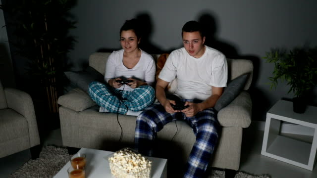 girlfriend can be your serious rival - gamepad stock videos & royalty-free footage