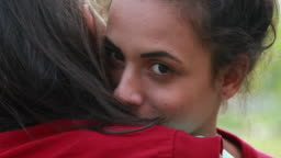 Girlfriend hugging lover embrace. Young woman face cuddling