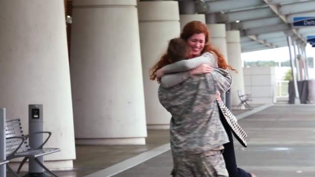 girlfriend welcoming home returning soldier at airport