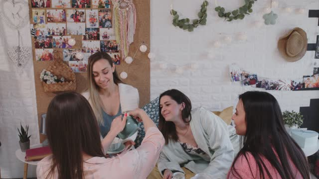 girlfriends about to enjoy tea while having a sleepover - nightwear stock videos & royalty-free footage