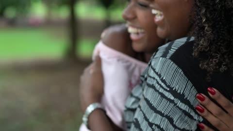 girlfriends embracing - innocence stock videos & royalty-free footage
