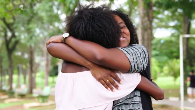 girlfriends embracing - love emotion stock videos & royalty-free footage
